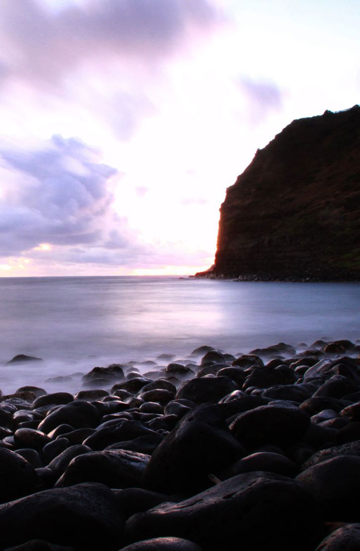 The tip of Halawa Bay silhouetted against early morning light on Molokai.