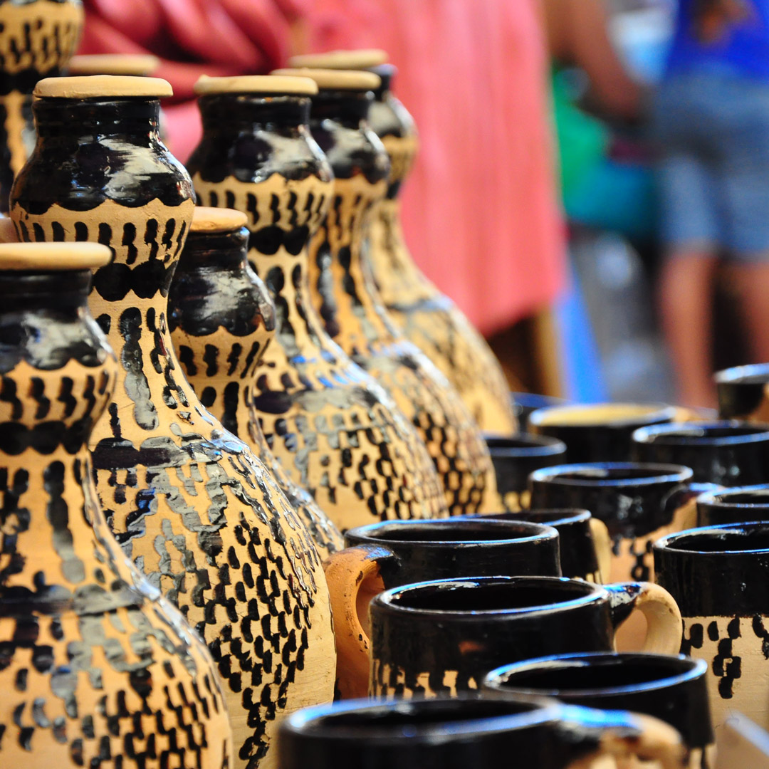 hand painted pottery on display at a Moroccan market