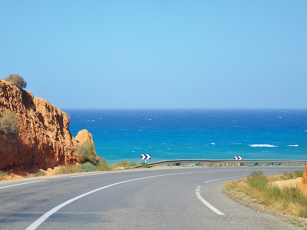 road curving along the coast of the Mediterranean in Morocco