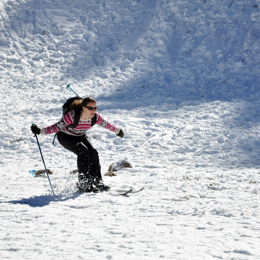 a woman skiing in morocco