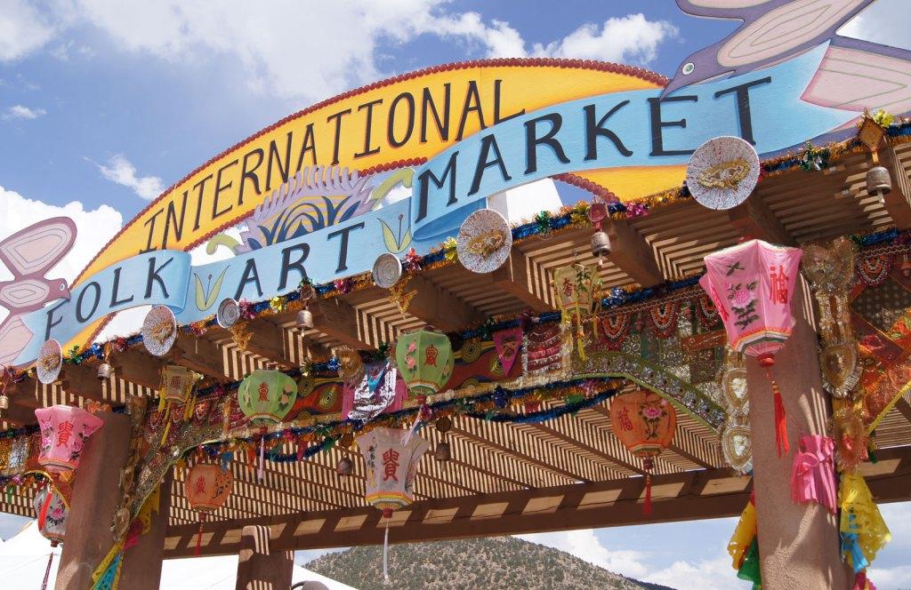 international folk art market sign