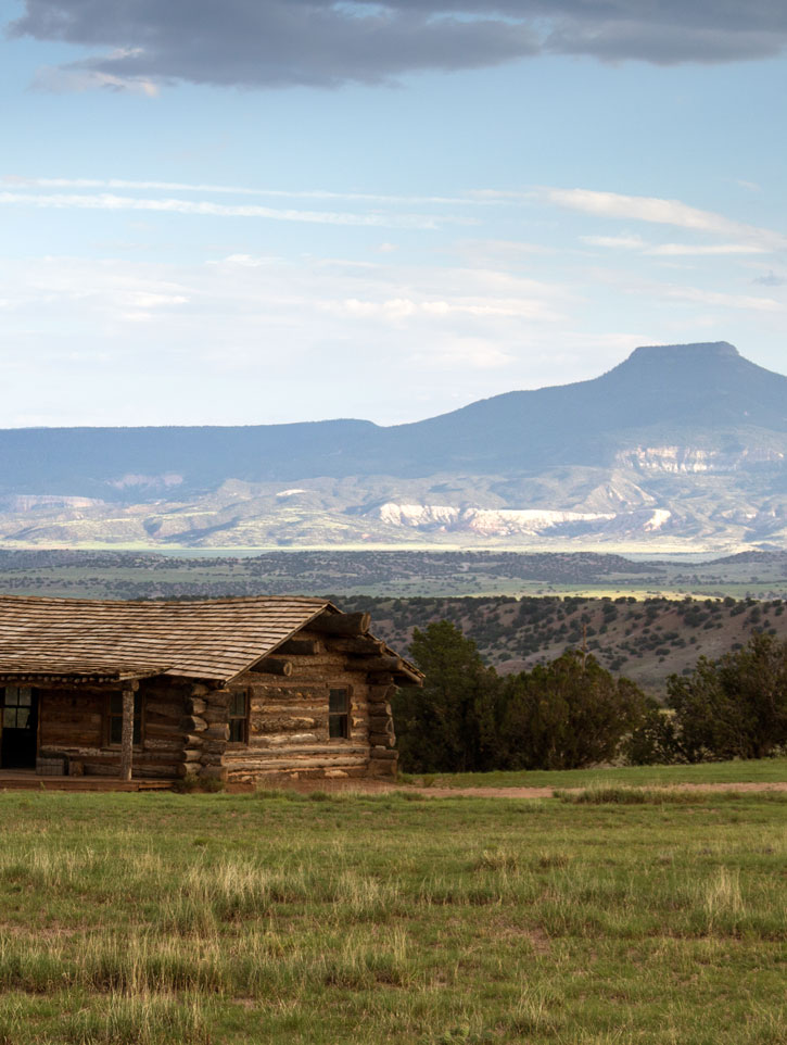 view of Pedernal Peak and cabin at Ghost Ranch.