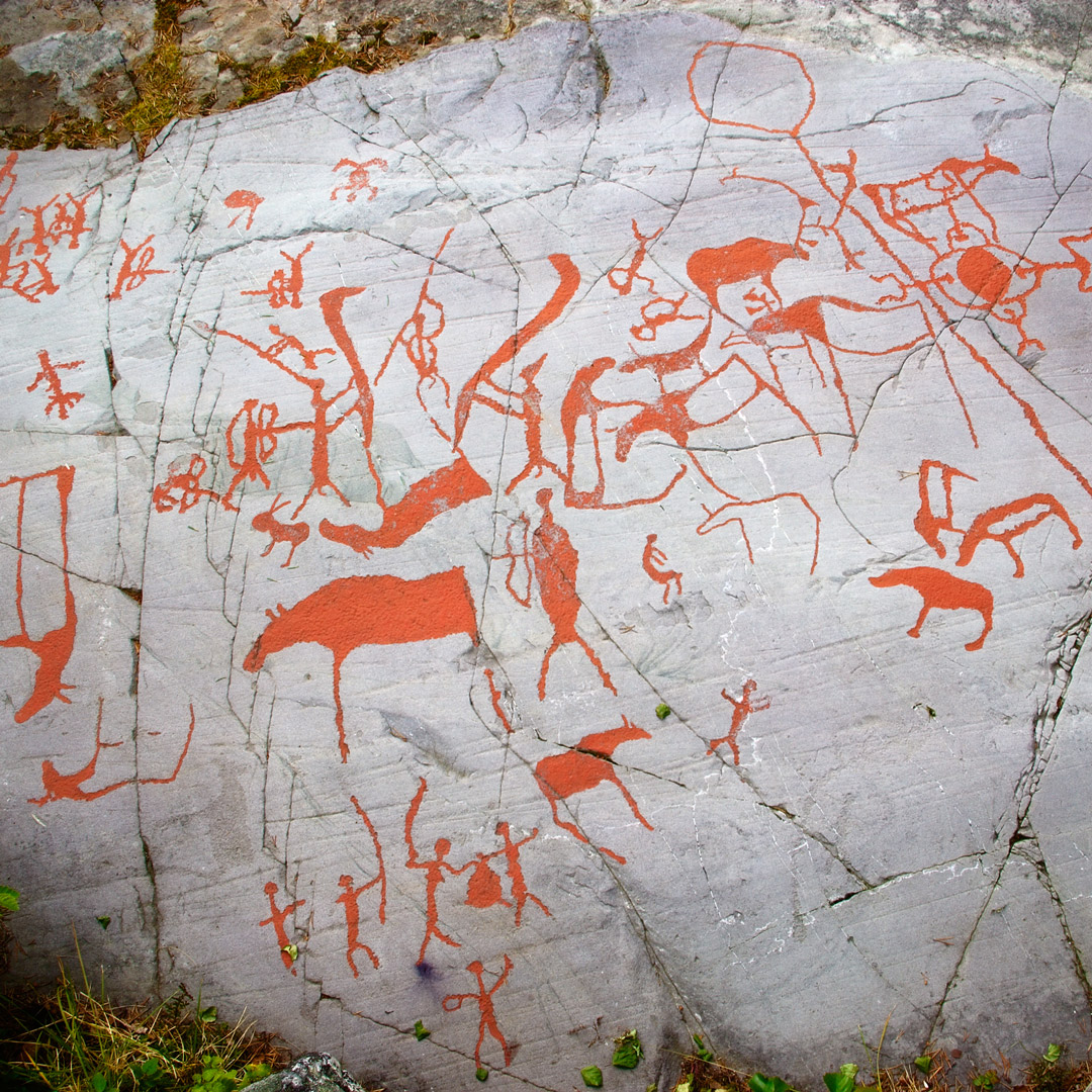 primitive red drawings on rock in Alta Norway