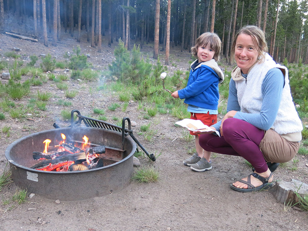 child and mother roasting marshmellows