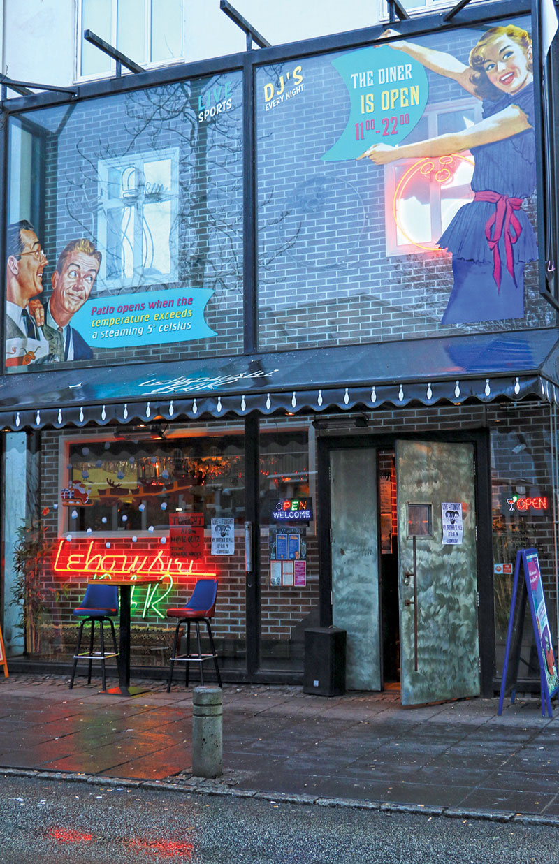 neon signs light up the Lebowski Bar in Reykjavik