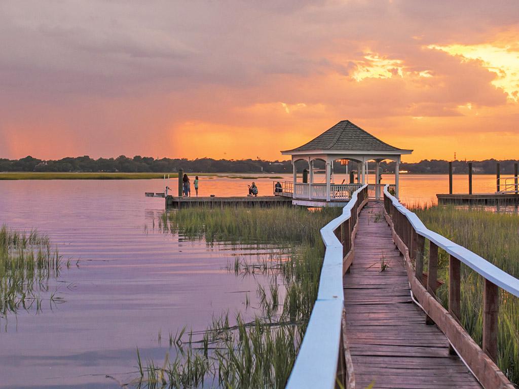 sunset casting purple and orange huges over Beaufort South Carolina