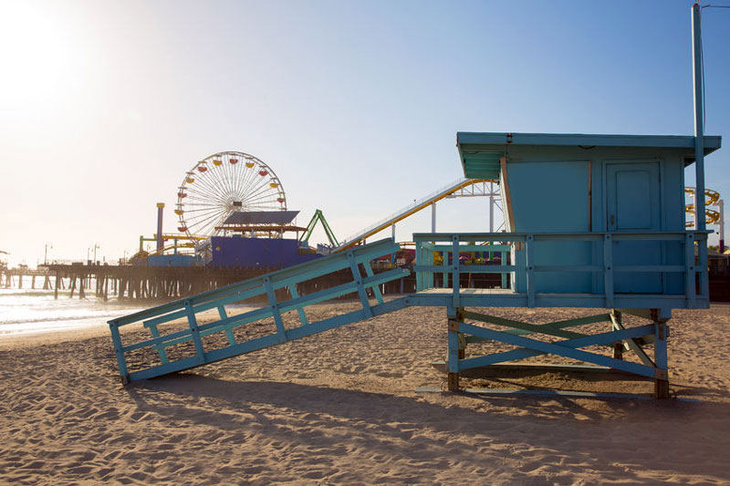 A lifeguard station on the beach next to the Santa Monica Pier.
