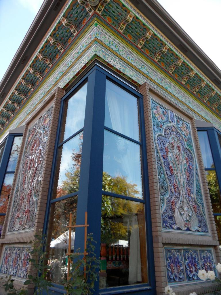 Beautiful exterior featuring mosaic work and tall windows