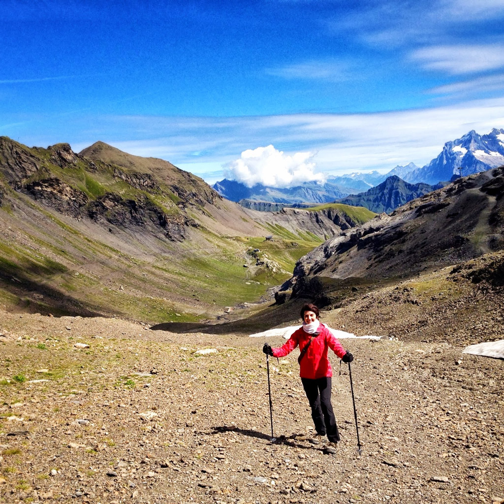 hiker with poles in the Swiss Alps