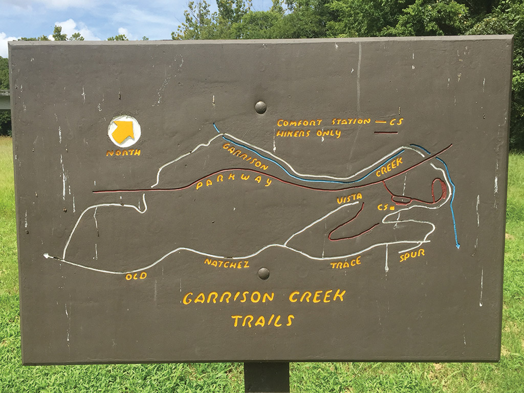 trail map carved into a wooden sign in Garrison Creek Tennessee