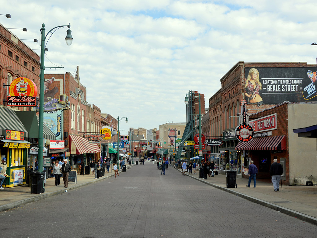 people walking along a shop-lined Beale Street in Memphis Tennessee