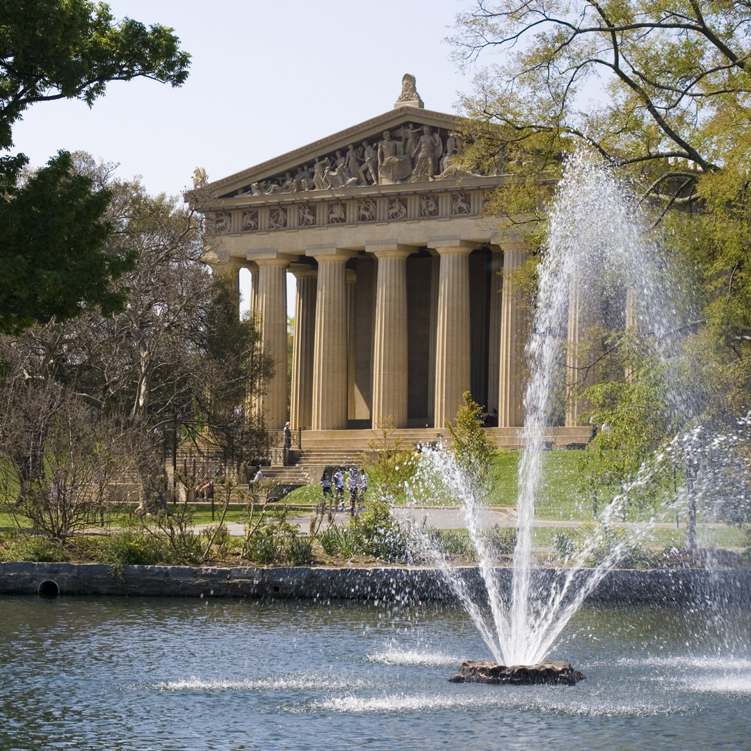 water streams from a fountain in front of the Parthenon in Nashville's Centennial Park