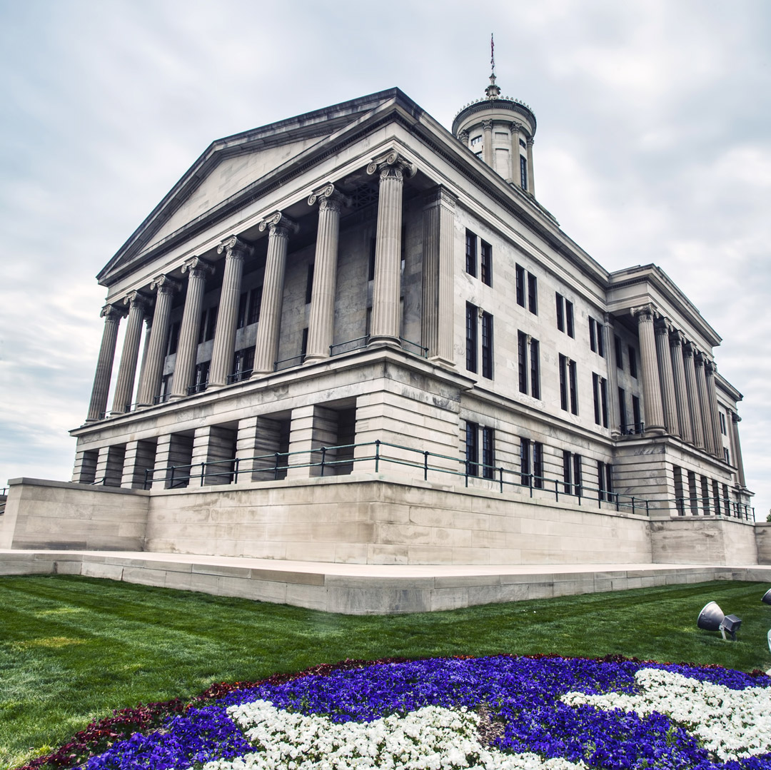 view from front lawn of Tennessee State Capitol Building with a flower bed designed to look like stars