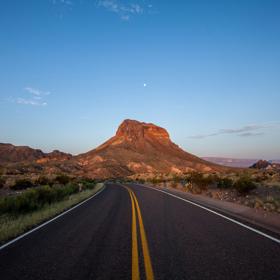 empty road leading to Castellan Peak in the Big Bend Area of Texas