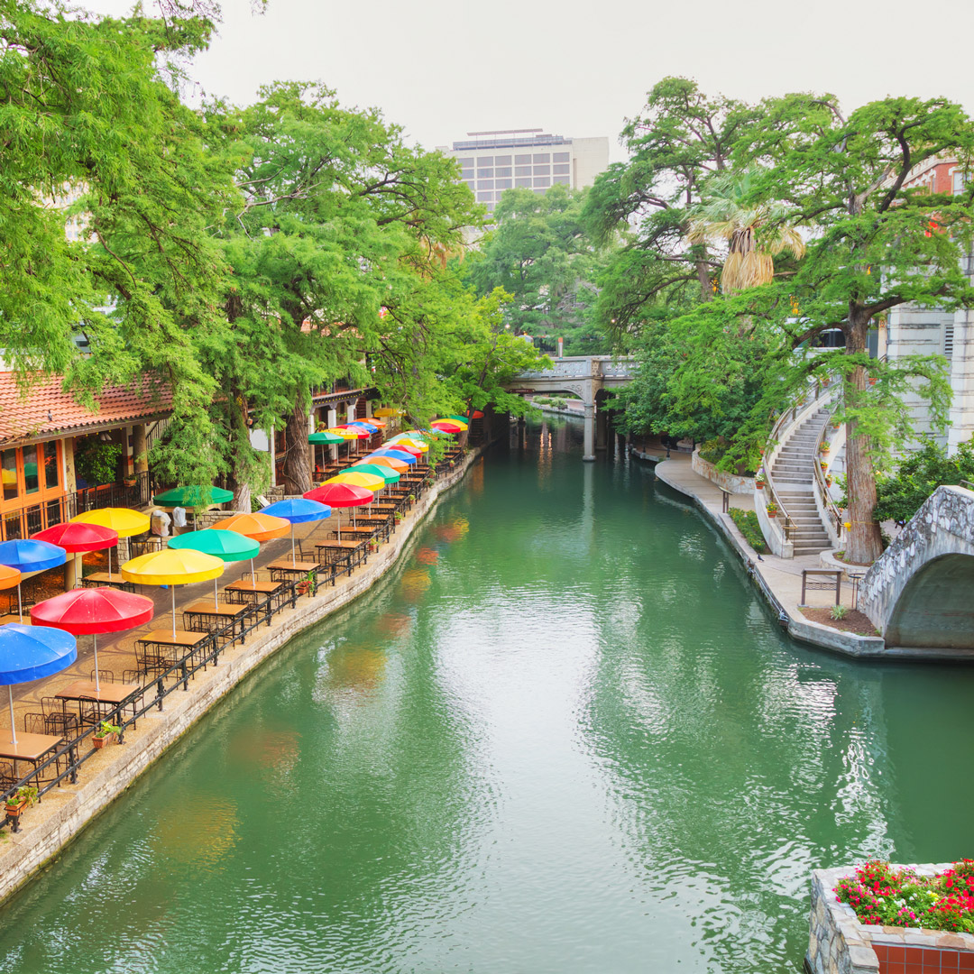 colorful umbrellas lining the san antonio river walk