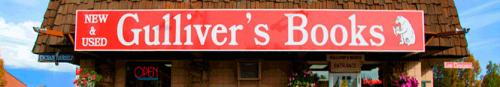A slice of the exterior of Gulliver's Books with a red sign, their bear logo and name