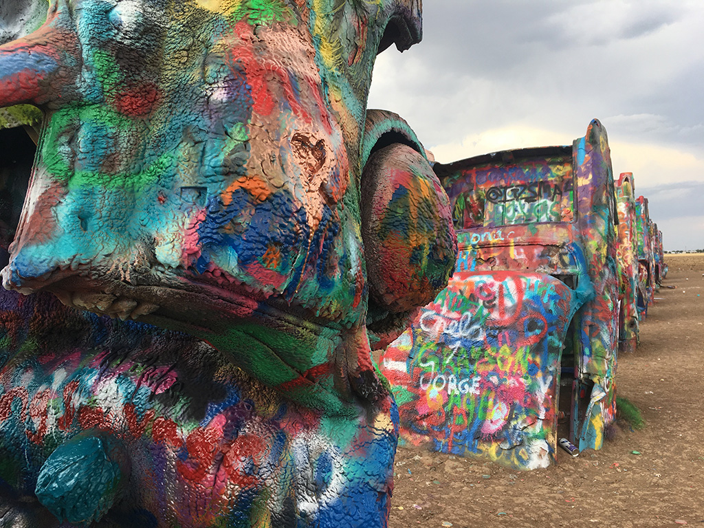 Spray painted cars sprout out of the ground at Cadillac Ranch in Amarillo.
