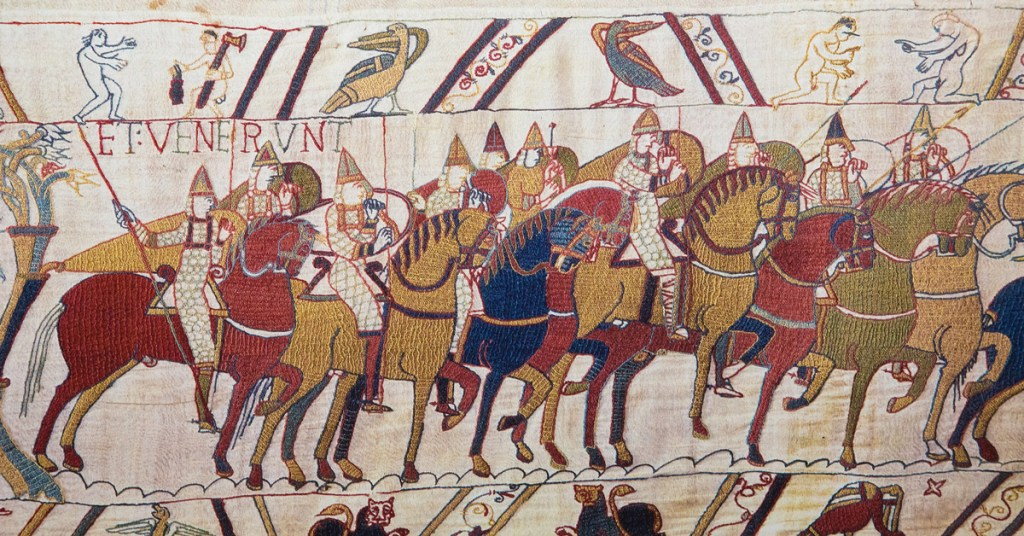 embroidered tapestry depicting norman soldiers on horseback