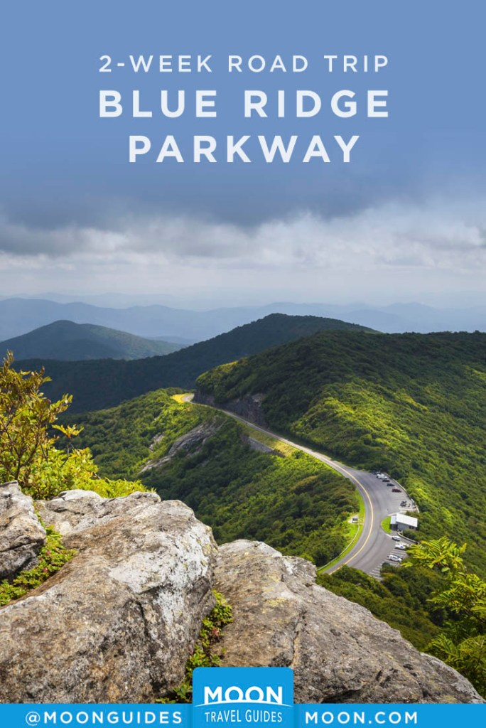 Aerial view of road twisting through green hills. Pinterest graphic.