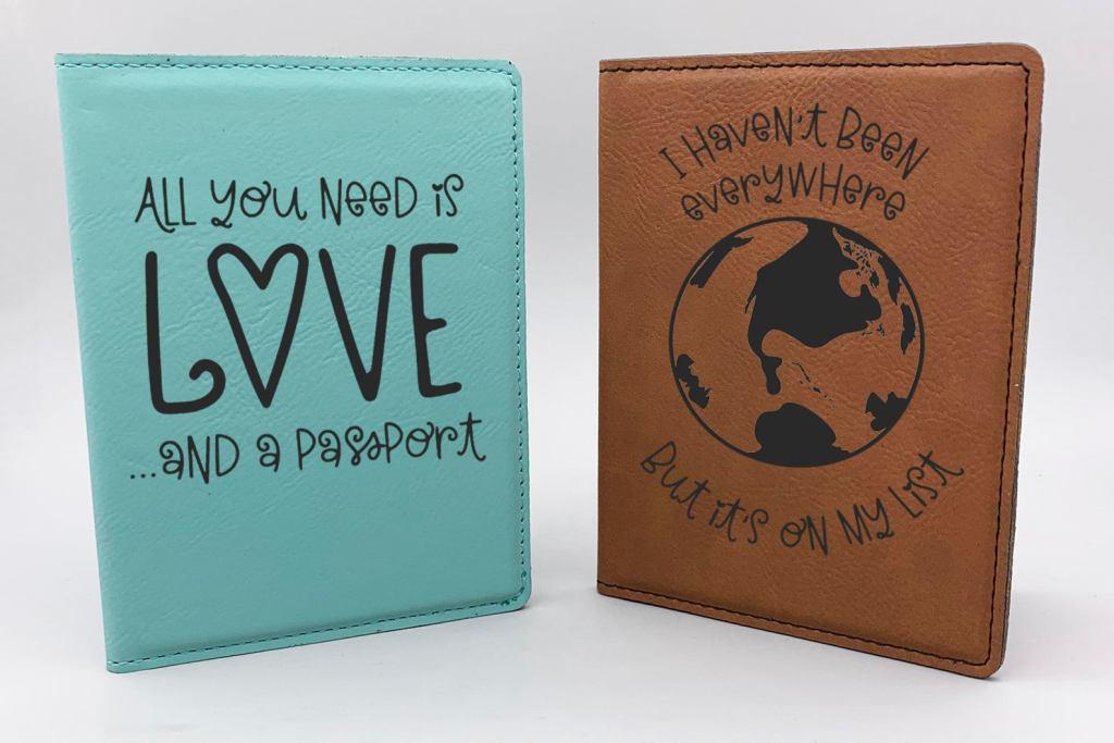 one aqua passport holder and one natural leather passport holder