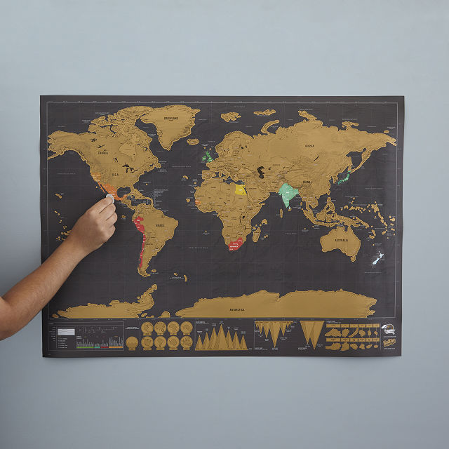 scratch-off world map hanging on a wall