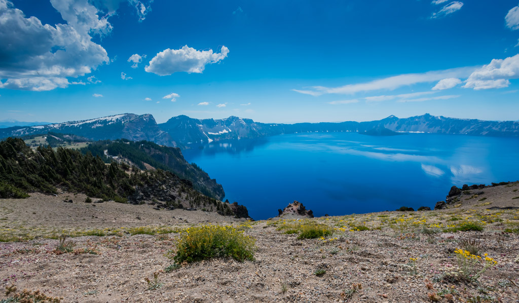 View of crater lake with clear blue water.