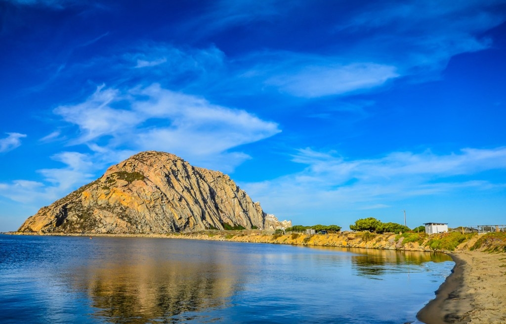 giant rocky land formation reflected in water