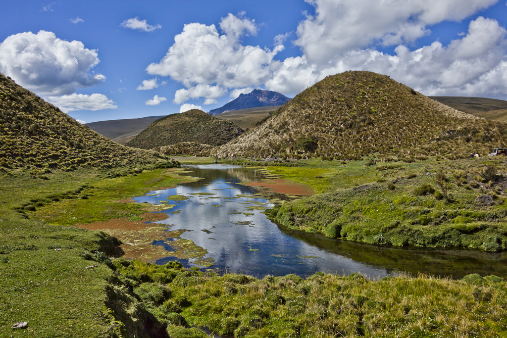 Photo of Cotopaxi National park with clear blue skies and green mounds