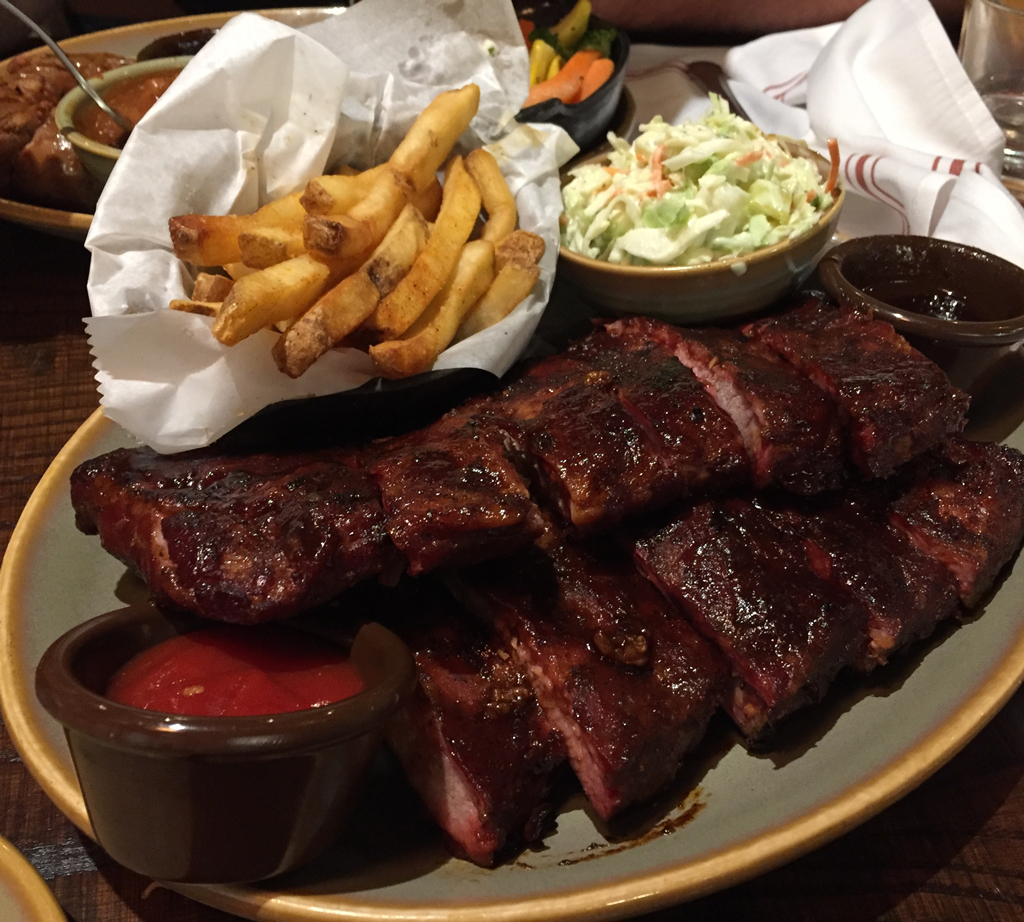 photo of bbq ribs, french fries, and cole slaw
