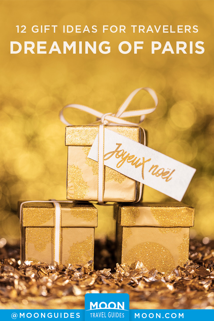 pinterest graphic with gold gift boxes tied with a boy and overlaid text reading gift ideas for travelers dreaming of paris