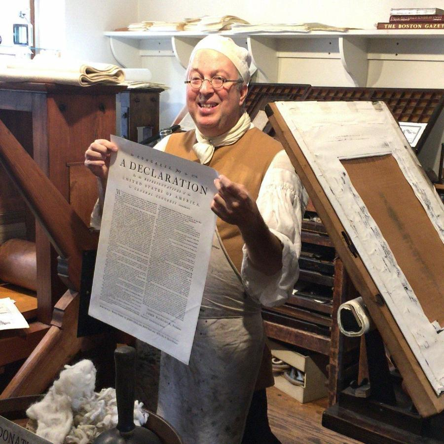 a person holding a declaration of independence print
