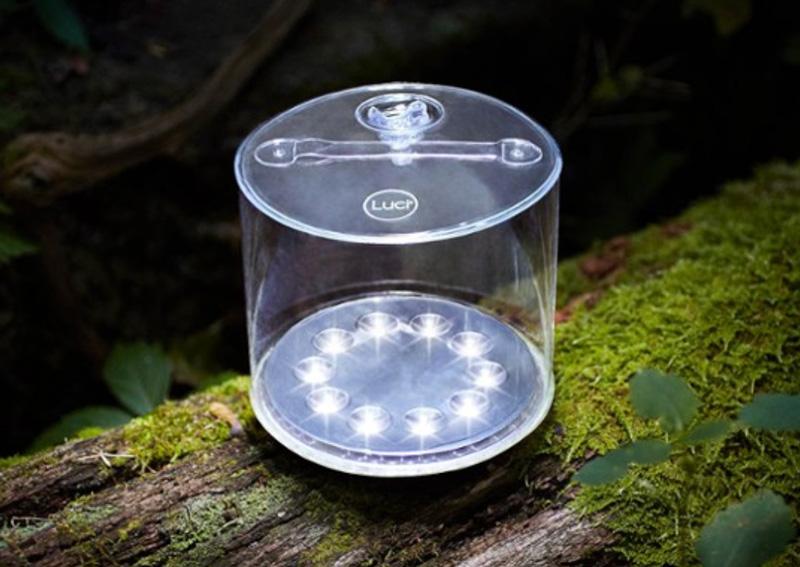 solar lantern sitting on a log