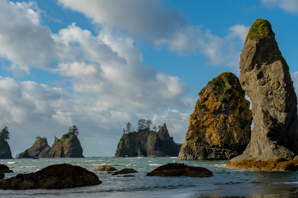 Point of the Arches at Shi Shi Beach in Olympic National Park with gloomy clouds and ocean view.