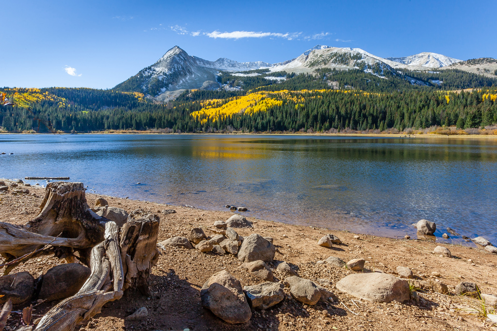 Lost lake with a scenic background of fall mountains.