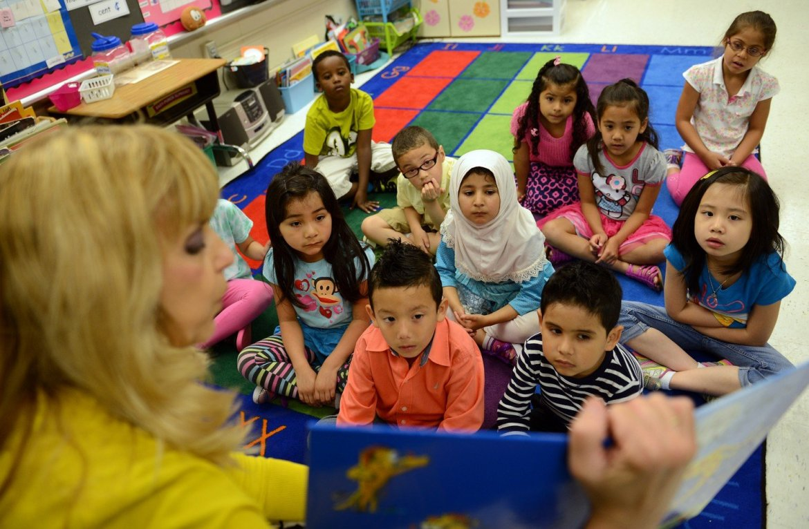 Students listen to teacher Heather Ulsh during a reading exercise at Lynbrook Elementary in Springfield, Va. (Astrid Riecken/For The Washington Post )