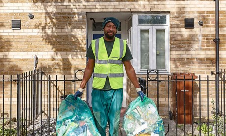 Council employee collecting recycling bags