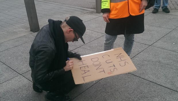 Stik signs a fan's placard. Photograph: Hackney Citizen