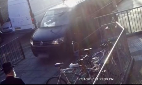 A video still shows a vehicle driving over the pavement in Oldhill Street