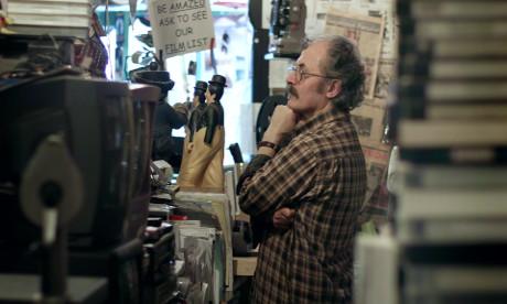 Ümit Mesut looks over the stock in his film emporium. Photograph: Liam Saint-Pierre