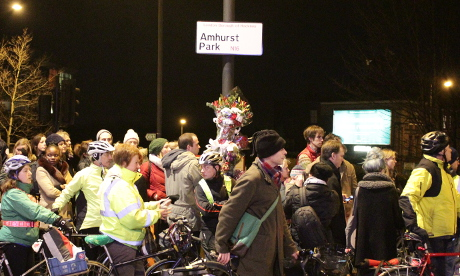 Cyclists gather at the crash spot on Amhurst Park