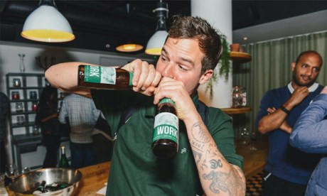 Got the bottle: Forest Road Brewing Co.'s Pete Brown chugs a couple of their pale ales, WORK.