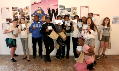Some of the young authors pose with their freshly minted CDs at the Red Gallery launch event. Photograph: Penguin Random House UK / Ministry of Stories