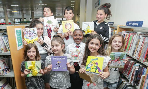 Picture perfect: the young authors pose with their creations at Shoreditch Library. Images: Penguin Random House UK