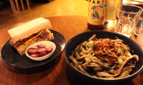 Shepherd's delight: the pork donkkaseu sandwich and the XO noodles at Shep's. Photographs: Jade King