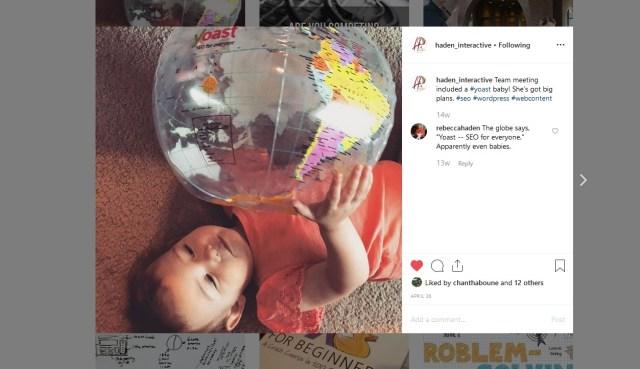 baby holding Yoast globe
