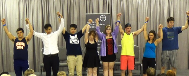 Aftergrad Hypnotist Hadlen has his volunteers bow at the end of the show in saskatoon