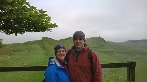 Kate and Bert Flather from Colerado Springs with the Wall snaking off behind them over the Whin Sill
