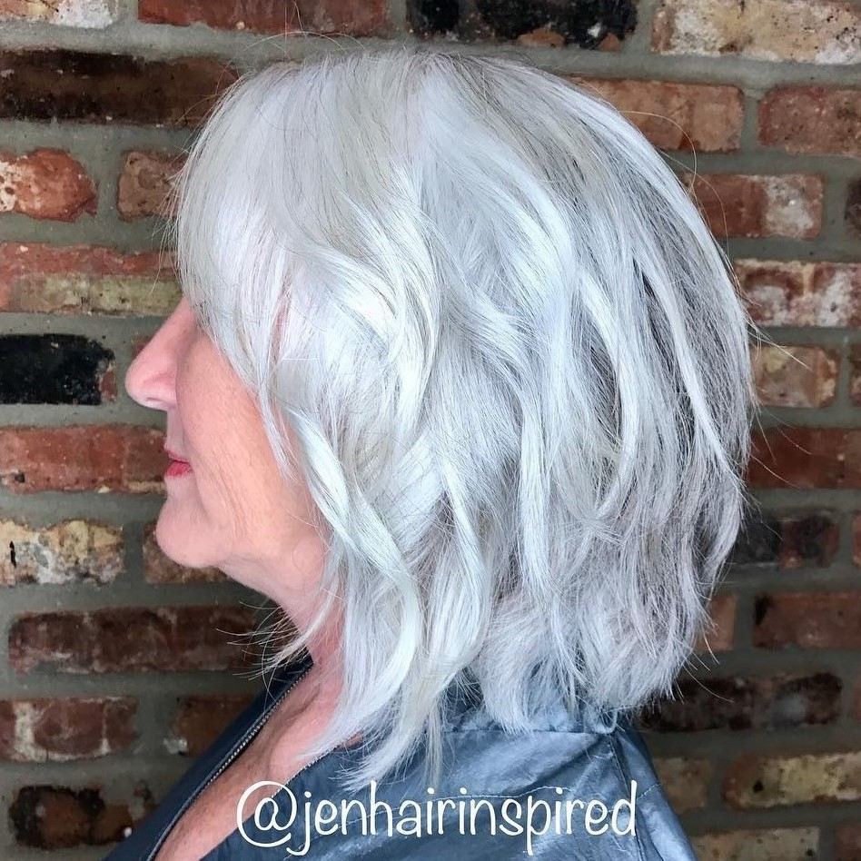 Medium Layered Silver Hairstyle for Older Women