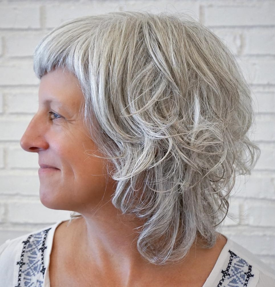 Medium Shaggy Gray Hairstyle with Short Bangs