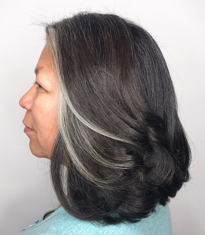 Brunette Hairstyle with Face-framing Gray Pieces